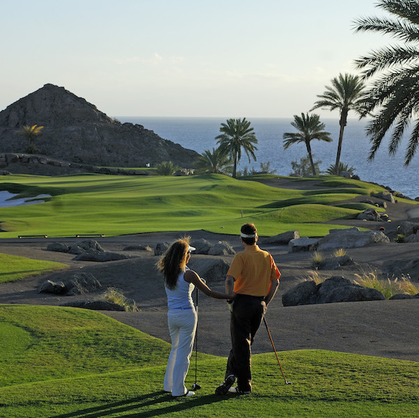 Two golfers survey the beauty of Anfi Tauro Golf, Gran Canaria