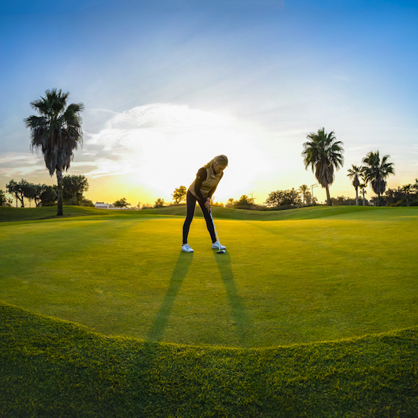 Woman Golfer putting on Roda Golf, Costa Calida