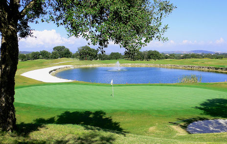 Water backs this green on San Roque Golf