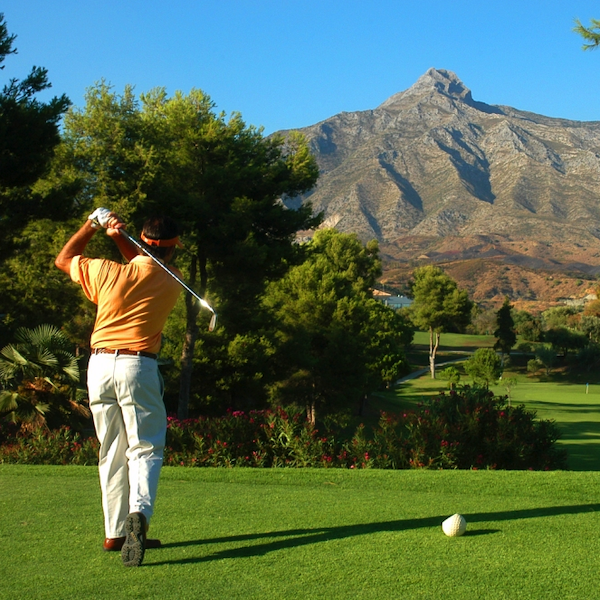 Man Golfer and Tee Shot at Aloha Golf, Costa del Sol, Spain