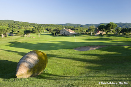 Golf D'Aro fairway with the club house in the background