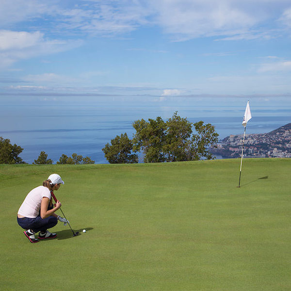 Putting on Palheiro Golf, Madeira, with view to the sea