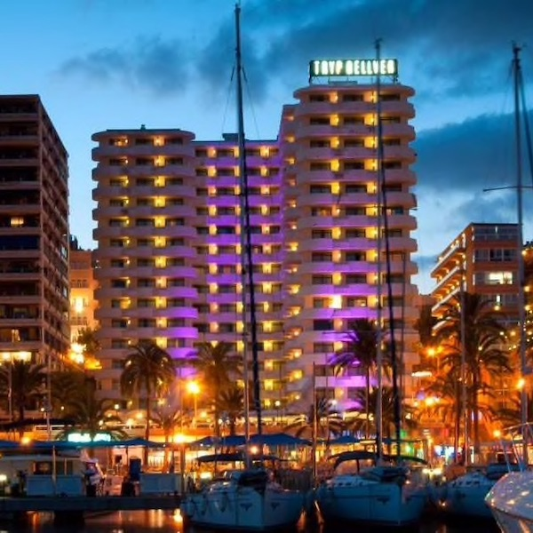 Night time shot of Palma Bellver Hotel with marina in the foreground