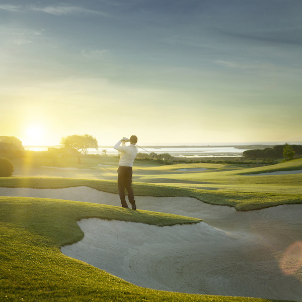 Player shoots from a bunker into the sun on Palmares Golf, Algarve