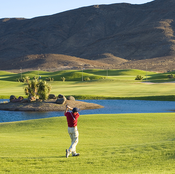 Golfer hits fairway shot on Playitas Golf, Fuerteventura