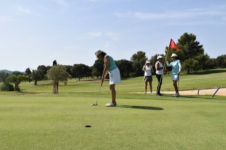 Putting out on Pollensa Golf