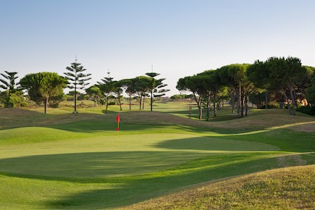 Green backed by umbrella pines on Sancti Petri Hills Golf