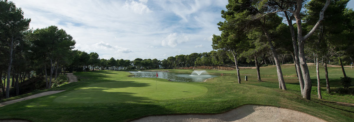 Green guarded by water on Son Servera Golf
